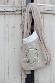 Hand-sewn fabric bag with embroidered snowdrops