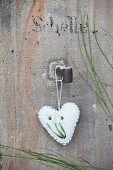 White boiled-wool heart embroidered with snowdrops