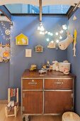 Workshop cabinet in nursery with blue walls and skylight