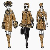 Three elegant fashion models side by side approaching camera wearing leopard print