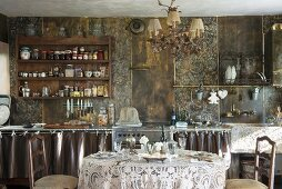 Shabby-chic ambiance in vintage, country-style kitchen with elegantly set dining table