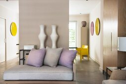Yellow and pastel mauve accents in elegant living area