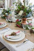 Table festively set and decorated with natural materials