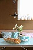 Hand-made wood-veneer bread basket on breakfast table