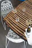 Delicate chairs at dining table made from barrel staves