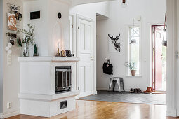 Masonry stove in bright foyer