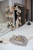 Silver votive heart decorated with initials and vintage-style ornaments
