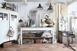 Collection of various vintage pieces in white interior
