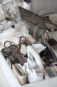 Vintage sewing utensils in old organiser