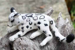 White, hand-made, felted, woollen leopard