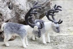 Two hand-made, felted, woollen reindeer
