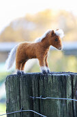 Hand-made, felted, woollen pony