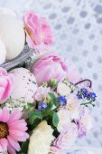 Easter flower arrangement with speckled egg