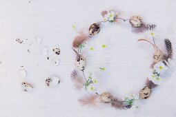 Romantic wire wreath, quail eggs, feathers and white flowers
