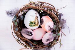 Vintage-style decorated Easter eggs and feathers in nest