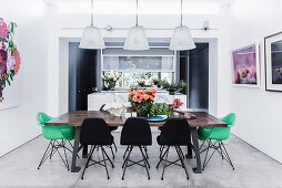 Vintage dining table and classic chairs in the dining area with concrete tiles
