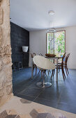 Modern shell chair and black floor in dining room