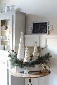 Lacy fabric Christmas trees and fir branches in old suitcase