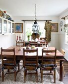 Rustic wooden table in dining room with white wainscoting