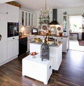Oriental accessories in rustic white kitchen