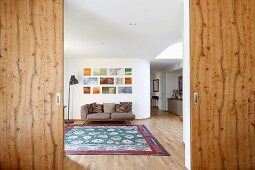 Open sliding wooden doors leaning into living room
