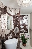 Mosaic walls with floral pattern in modern bathroom with curved walls