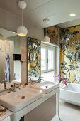Gold floral mosaic above bathtub in luxurious bathroom