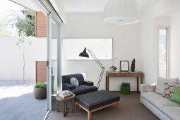 Reading corner next to open terrace doors