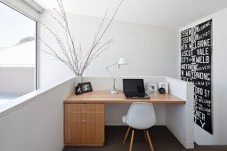 Modern, black and white wall hanging next to fitted desk on gallery
