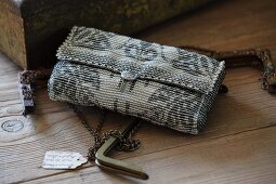 Elegant Art-Deco evening bag on rustic wooden surface