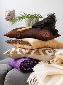 Stacked pillows and feather duster