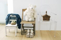 Three different children's chairs, small basket and toy sheep
