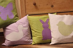 Hand-sewn scatter cushions with Easter motifs