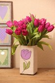 Tulips in vase with hand-made cover