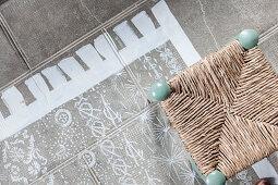 Rush-bottom chair on painted rug