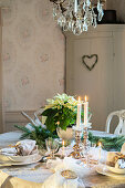 Table festively set in shades of silver and cream