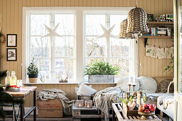 Paper stars in window in rustic living room