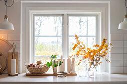 Autumnal arrangement in kitchen window