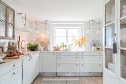 White country-house kitchen decorated with natural accessories