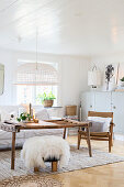 Rustic coffee table in white living room with wooden ceiling