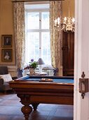 Billiard table in games room of stately home
