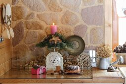 Advent arrangement of candle and wooden star on vintage kitchen scales