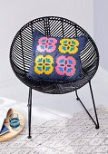 A denim cushion cover with felt flowers