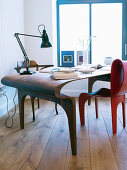 Wooden desk and red chairs in futuristic design