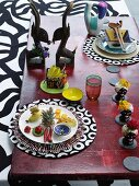 Table set with ethnic ornaments and round place mats