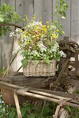 Cow parsley, red campion and buttercups in wicker basket