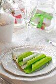Serviettes folded into Christmas tree shape on white plate