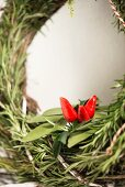 Hand-made wreath of herbs decorated with chillies (detail)