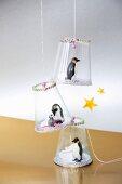Festive pendants with penguin figurines
