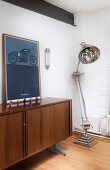 Large anglepoise lamp next to picture of motorbike on sideboard